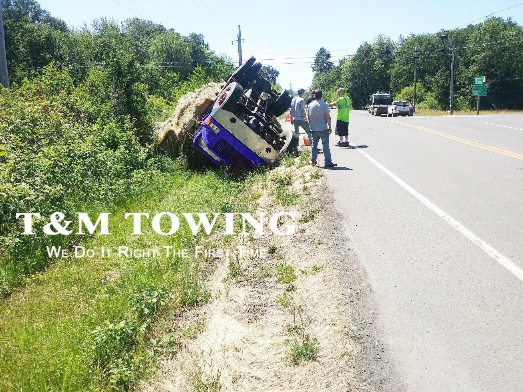 Hay on Trailer Needing a Heavy Tow Truck
