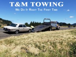 Mercedes being loaded by tow truck company Eugene Oregon