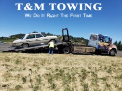 Mercedes half way up ramp by tow truck company Eugene Oregon