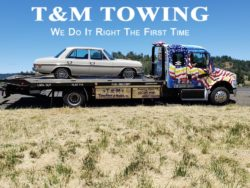 Mercedes on flatbed by tow truck company Eugene Oregon