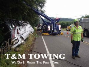 Watch RV Towing in action with motorhome lying on side