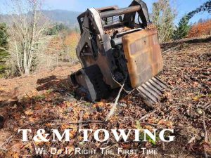 Burned out bobcat before Springfield Heavy Towing